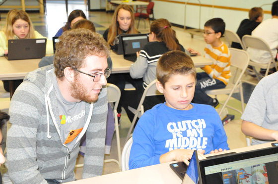 2011 Shaker HS graduate and current RPI student/Microsoft Ambassador, Joshua Goldberg, works with a Latham Ridge sixth grader during the hour of code.