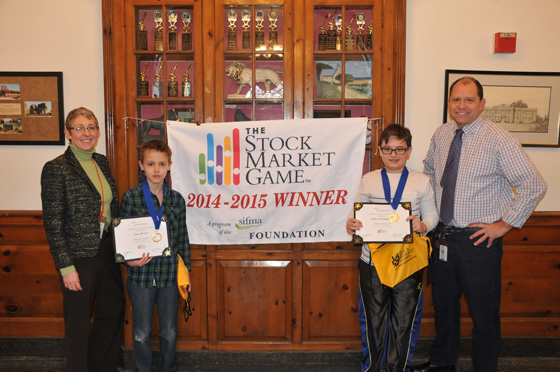Loudonville Principal Flynn and sixth grade teacher Mr. Springstead with students Peter Mostert and Robert Fratangelo, the 2014-2015 Stock Market Game winners.