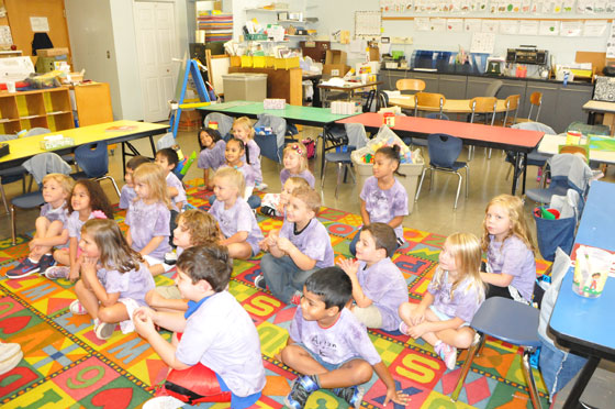 Boght Hills kindergarten students listen to a story being read.