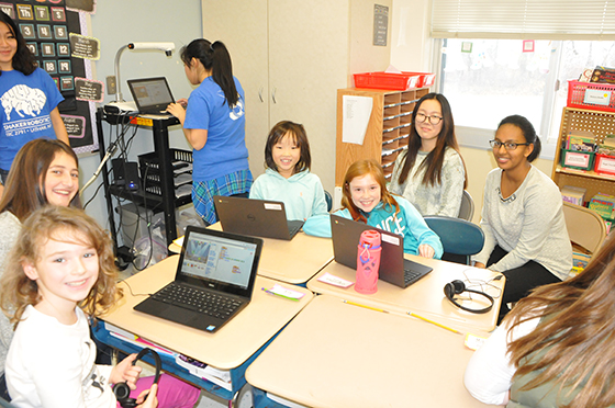 Third grade Boght Hills students team up with Shaker High School computer science students to learn code.