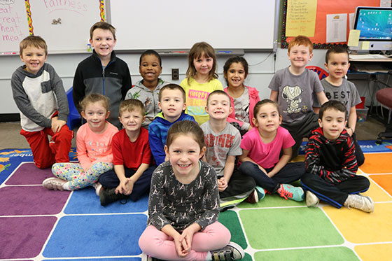 picture of first grade class and North Colonie Kids Care student for March 2017