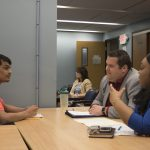 Student at NYS Office of Information Technology Services in a mock interview