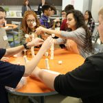 Students at Pioneer Bank participating in a team building activity.