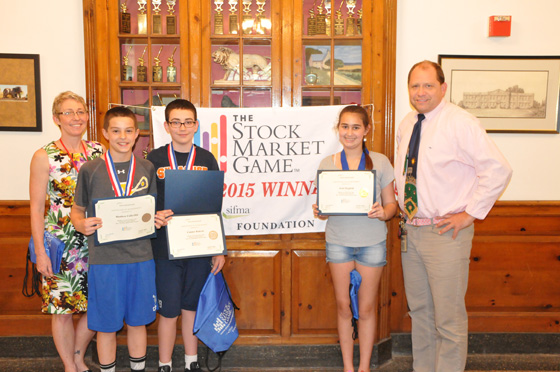 Loudonville Principal Flynn and sixth grade teacher Mr. Springstead with students Connor Ruberti, Matthew Calicchia, and Ariel Siegfeld, the winter 2014-15 Stock Market Game winners.
