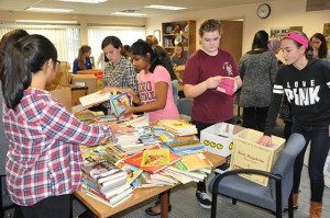 Students sort books.