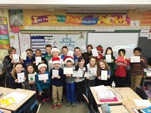 Students in Liz Chlopecki's 4th grade class share the cards they made for Safyre Terry.