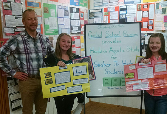 Alexah Bedard and Elizabeth Bazinet present to Friends of Five Rivers with SJHS science teacher, John Slyer.