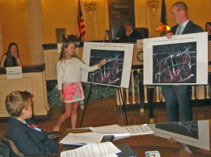 picture of student pointing at charts in courtroom