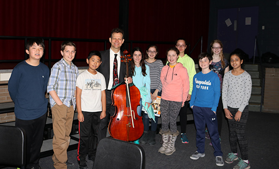 Robert Cafaro with ten North Colonie cellist players