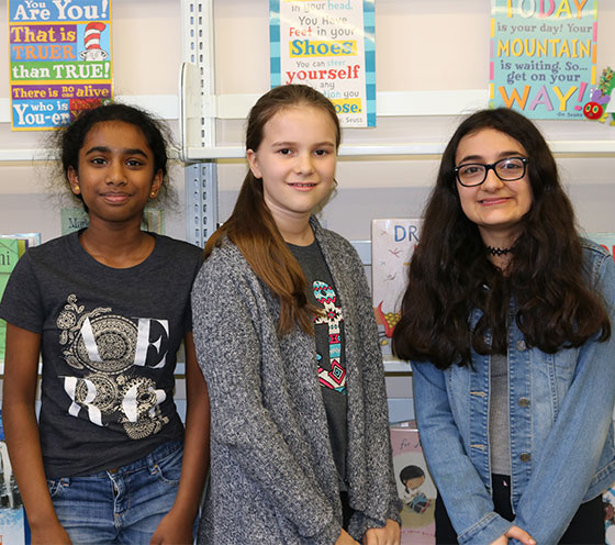 picture of three sixth-grade book club students