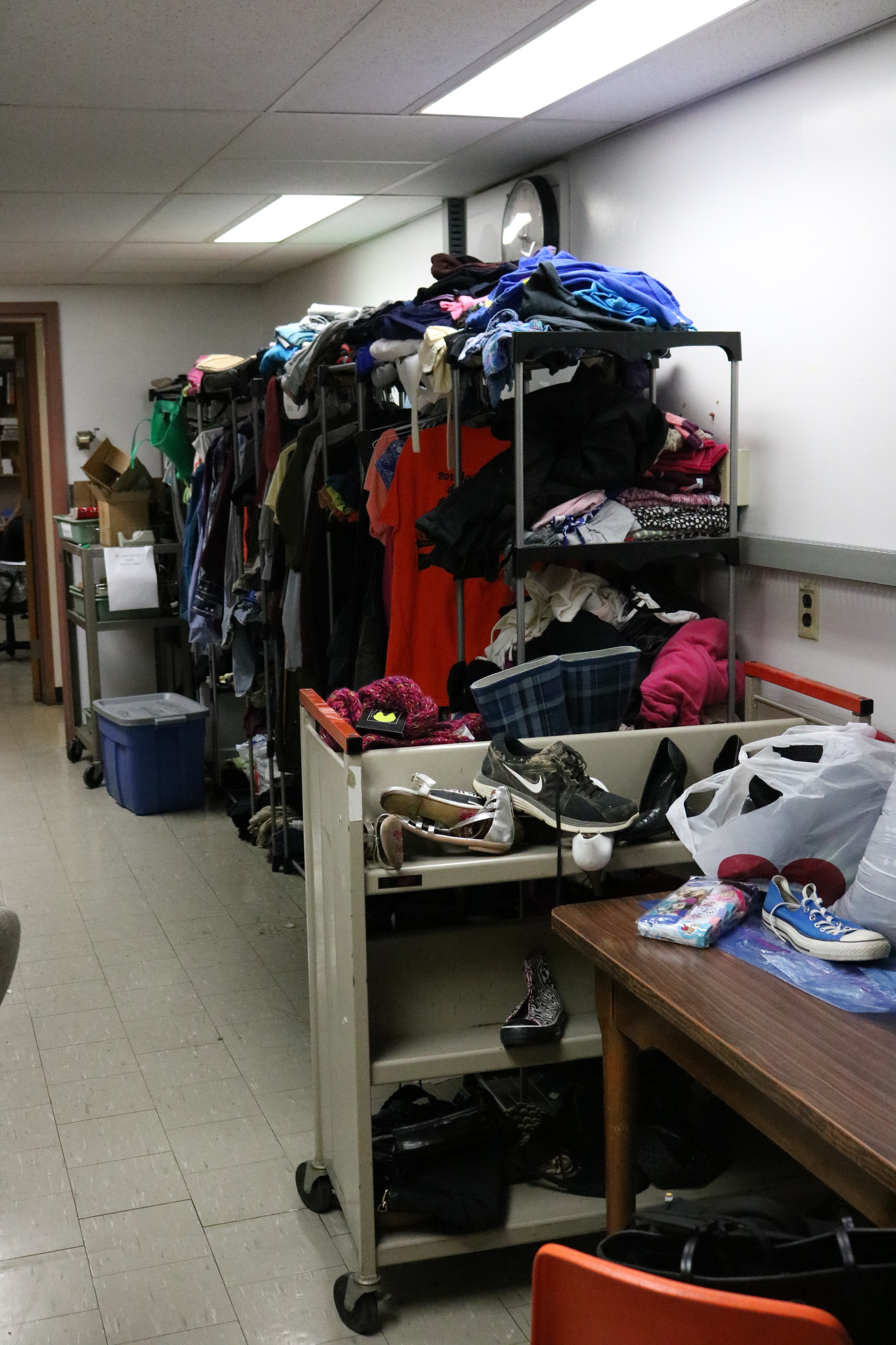A large room filled with closet organizers and clothing.