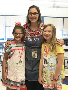 Laura Duffy with two third grade students