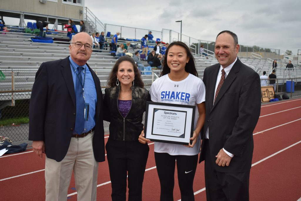 Superintendent Joseph Corr, Marisa Jacques, Jenny Seo, and Kevin Egan pose for a picture.