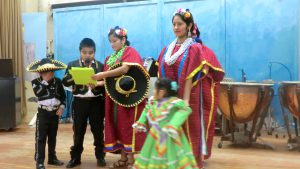 students and parents prepare for a tradition Mexican dance at the International Food Festival