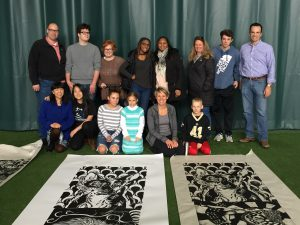 Students and their family members with the completed pieces of art