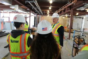 students and administrators are taken on a construction tour of the new sjhs wing