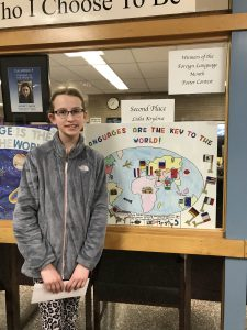 Lidia Krylova poses with her 2nd place-winning poster