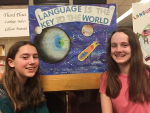 Caitlyn Asher and Lillian Buresh pose with their third-place winning poster