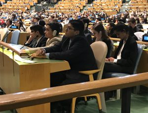 Students in Model U.N. Club listen to discussions in the United Nations General Assembly Hall.