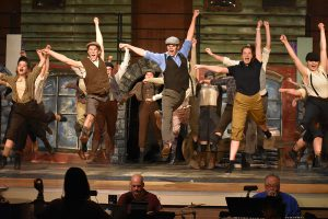shaker high school students perform in the musical newsies