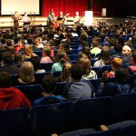 Sixth grade students learn about classical music, serenaded by alumni