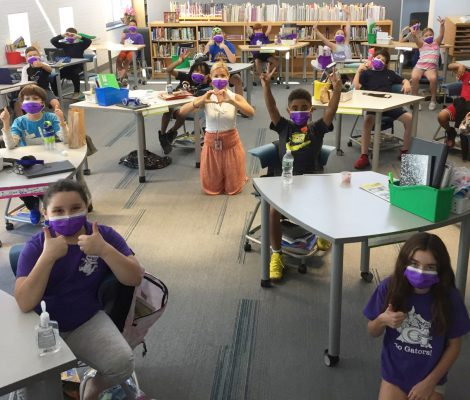 5th grade class sitting at desks wearing masks