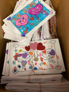 Handmade, colorful Valentines stacked up in a box